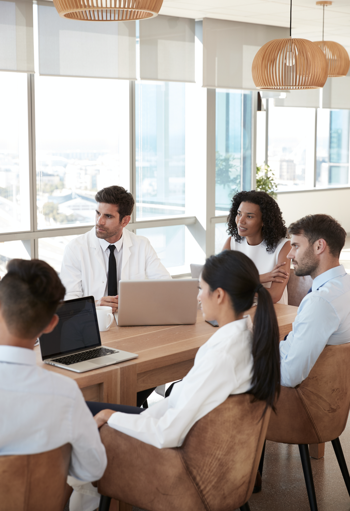 Doctors at a conference table