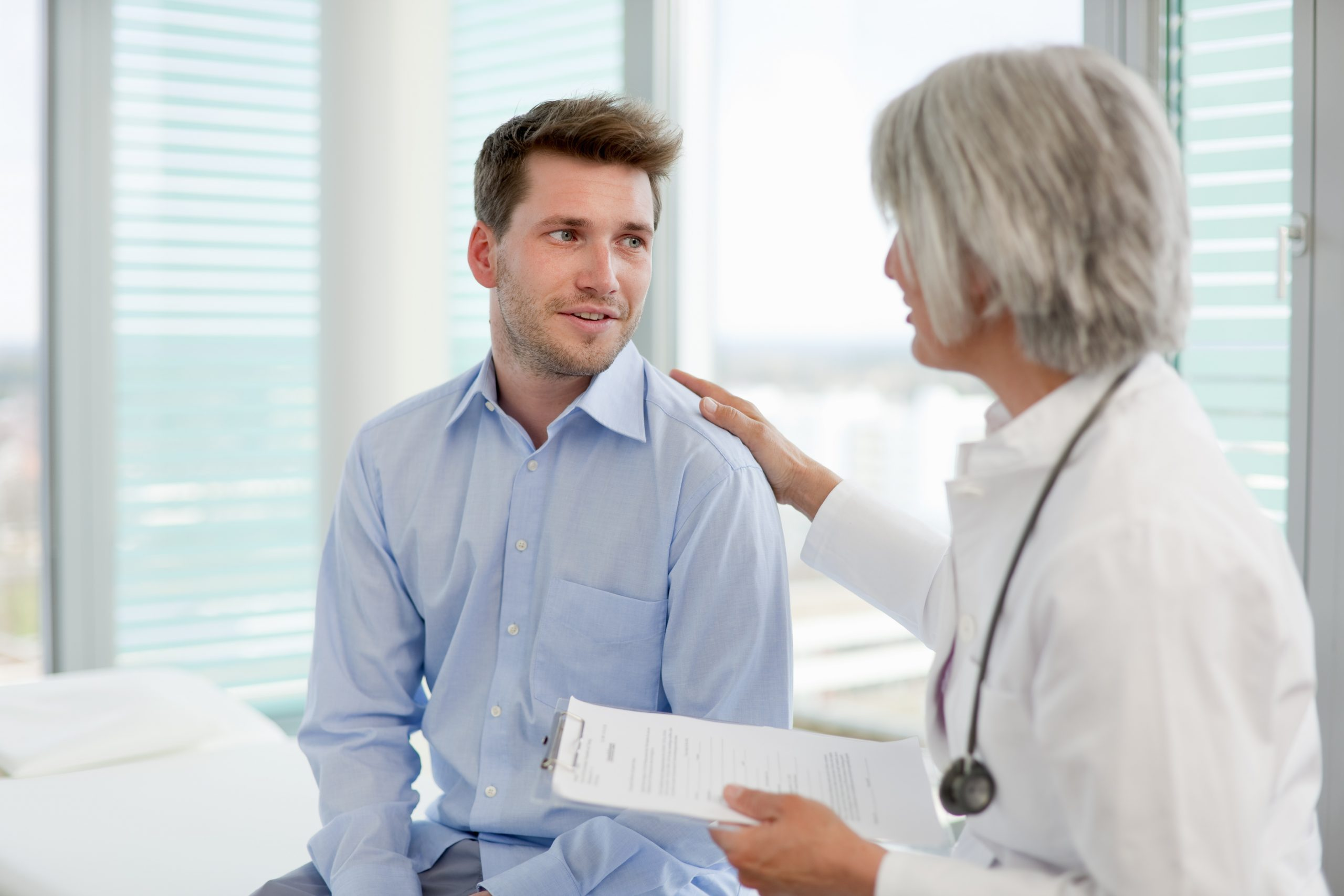Doctor reviewing form with patient